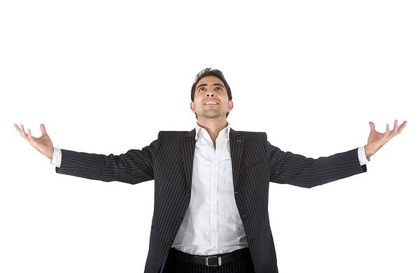 Sucessful business man with arms opened - isolated over a white background
